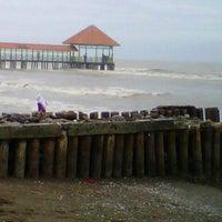 Photo taken at Pantai Purwahamba Indah by norma w. on 12/31/2013