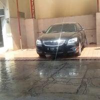 Photo taken at Cikopo Car Wash by Riana O. on 9/17/2014