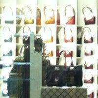 Photo taken at Longchamp by monymarial on 10/23/2012