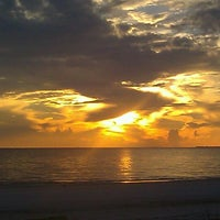 Photo taken at Fort Myers Beach by Katie D. on 10/6/2012