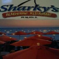 Photo taken at Sharky's Beachfront Restaurant by Angela T. on 11/18/2012
