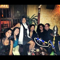 Photo taken at Cozy Cafe Hookah Lounge by Kash G. on 10/6/2012