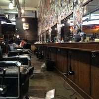 Photo taken at Rudy's Barbershop by Michelle C. on 12/29/2012