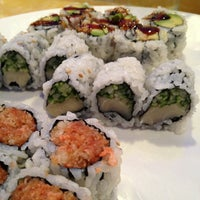 Photo taken at Umami Sushi by Angela W. on 5/29/2013