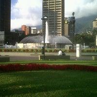 Photo taken at Plaza Venezuela by Melissa A. on 12/2/2012