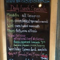 Photo taken at Brick Oven on 35th by Addie B. on 12/21/2012