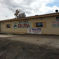 Photo taken at Bloom's Mill Hill Saloon by Lori B. on 3/26/2014