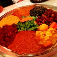 Photo taken at New Eritrea Restaurant & Bar by Grace C. on 12/12/2012