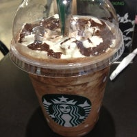 Photo taken at Starbucks by clairinnee on 1/2/2013