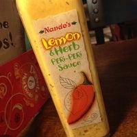 Photo taken at Nando's by Tina E. on 11/7/2012