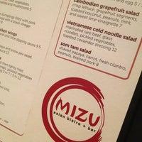 Photo taken at Mizu Asian Bistro + Bar by Tina E. on 7/16/2013