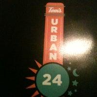 Photo taken at Tom's Urban by Kelli B. on 12/9/2012