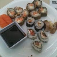 Photo taken at Wok Sushi by Geíza M. on 10/4/2012