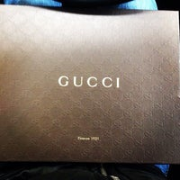 Photo taken at Gucci by Паша К. on 10/21/2014