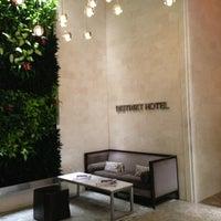 Photo taken at Distrikt Hotel New York City by Lola S. on 1/29/2013