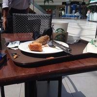 Photo taken at Starbucks- Marinamall by Bashar A. on 8/25/2014