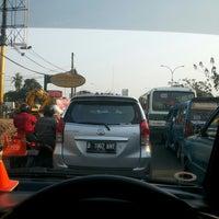 Photo taken at Jalan Margonda Raya by Ari W. on 9/27/2014