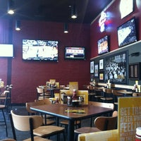 Photo taken at Buffalo Wild Wings by Ivey M. on 2/16/2013