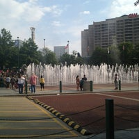 Photo taken at Centennial Olympic Park by Katia G. on 7/28/2013