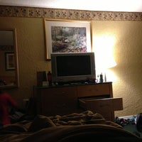 Photo taken at Howard Johnson Hotel by Anna Ivelisse V. on 3/30/2013