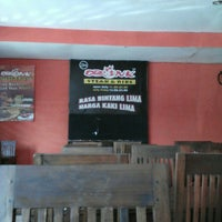 Photo taken at Obonk Steak & Ribs by Dina on 4/9/2015