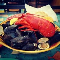 Photo taken at Gilligan's Clam Bar and Grill by Jon Jon on 8/25/2013