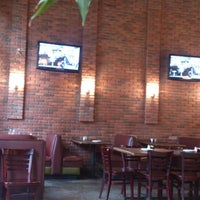 Photo taken at Buono's Pizzeria by Tina J. on 2/22/2015
