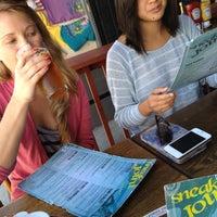 Photo taken at Sneak Joint by Cara N. on 10/12/2012