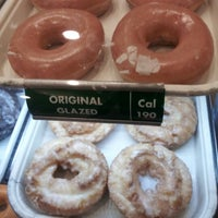 Photo taken at Krispy Kreme Doughnuts by Kim C. on 12/30/2012