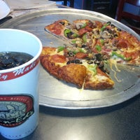 Photo taken at Me-n-Ed's Pizza by Reggie S. on 3/12/2013