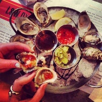 Photo taken at L&W Oyster Co. by Abi B. on 5/23/2013