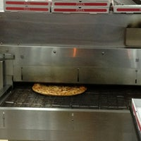 Photo taken at Crunchy Pizza by Edgar C. on 8/13/2013