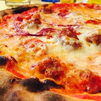 Photo taken at Bocconi Cafe' Ristorante Pizzeria Cocktail Bar by Tesoro on 1/2/2015