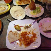 Photo taken at India Palace Restaurant by Carmen on 1/21/2015