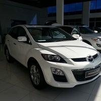 Photo taken at Dunia Prestasi Auto Sdn Bhd (Mazda Showroom) by Hezreen H. on 4/27/2013