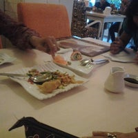 Photo taken at DE CAFÉ Resto & Delicatessen by Andi Syahrir M. on 12/12/2012