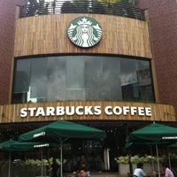Photo taken at Starbucks Coffee @ New World Hotel by Ricardo R. on 7/7/2013