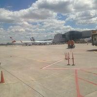 Photo taken at Gate F96 by Dennis G. on 6/16/2013