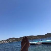 Photo taken at Doria Beach by Ebru E. on 9/7/2017