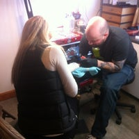Photo taken at Chameleon Tattoo and Body Piercing by Katie M. on 3/24/2013