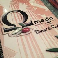 Photo taken at Omega Diner by Monica Z. on 1/1/2013