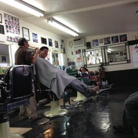 Photo taken at Miracle Barber Shop by Teddy C. on 12/15/2012