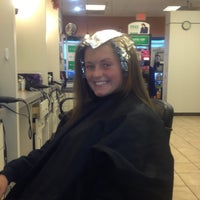 Photo taken at Famous Hair by Kimberly T. on 12/14/2012