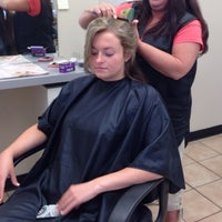 Photo taken at Famous Hair by Kimberly T. on 5/3/2014