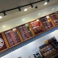 Photo taken at Tom N Toms Coffee by DAR on 6/28/2014