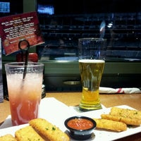 Photo taken at TGI Fridays Front Row Sports Grill by Mia S. on 12/15/2012