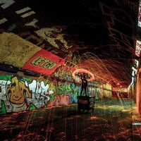 Photo taken at Leake Street Graffiti Tunnel by Jam A. on 10/6/2014
