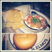Photo taken at St. Elmo's  Seaside Brasserie by Aline C. on 12/21/2012