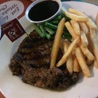 Photo taken at Holycow! Steakhouse by Ari P. on 9/30/2012