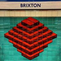 Photo taken at Brixton London Underground Station by carcher 8. on 5/7/2013